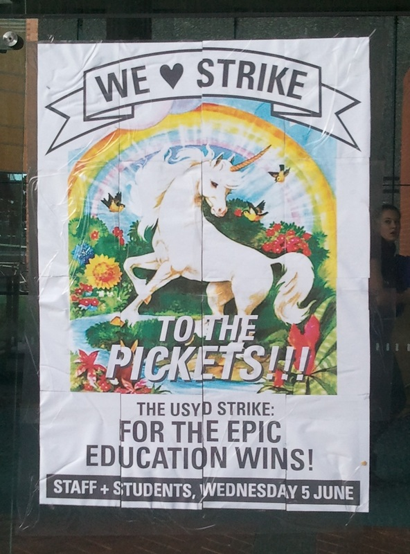 Extra large poster, featuring a unicorn, seen at Sydney Uni before the strike